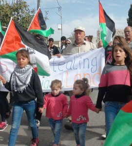 Nabi Saleh girls, including the teeny blond twins that I saw, out front at a November 2014 protest.  Photo by Bilal Tamimi.
